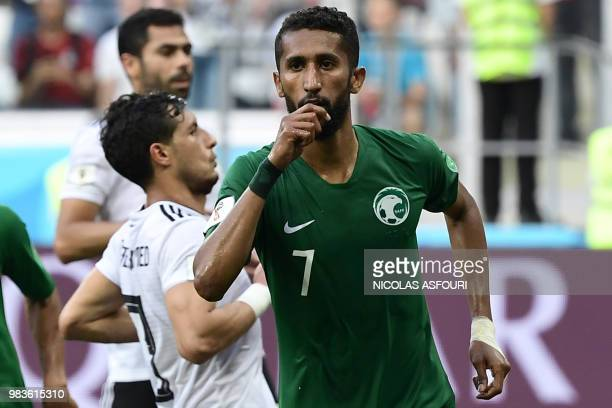 Saudi Arabia's midfielder Salman AlFaraj reacts after scoring from the penalty spot during the Russia 2018 World Cup Group A football match between...