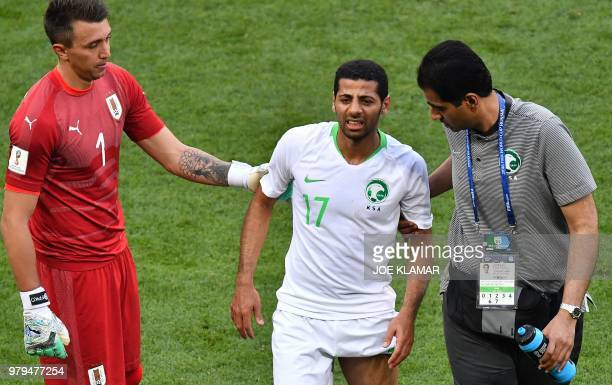 TOPSHOT Saudi Arabia's midfielder Taisir AlJassim leaves the pitch on an injury during the Russia 2018 World Cup Group A football match between...