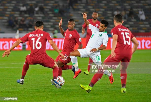 Saudi Arabia's midfielder Yahya AlShehri vies for the ball with Saudi Arabia's midfielder Hussain Al Moqahwi during the 2019 AFC Asian Cup group E...