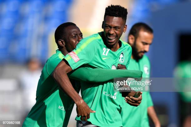 Saudi Arabia's midfielders Abdulmalek AlKhaibri and Mohamed Kanno attend a training session on June 10 2018 before the upcoming 2018 football World...