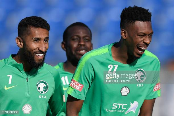 Saudi Arabia's midfielders Salman AlFaraj Abdulmalek AlKhaibri and Mohamed Kanno attend a training session on June 10 2018 before the upcoming 2018...