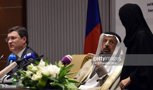 Saudi Arabia's Minister of Energy Industry and Mineral Resources Khalid AlFalih speaks to a female aide during a press conference with his Russian...