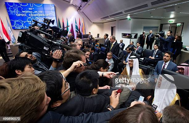 Saudi Arabia's minister of Oil and Mineral Resources Ali alNaimi is surrounded by journalists as he attend the 168th Ordinary meeting of the...