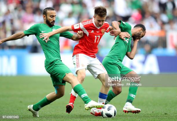 Saudi Arabia's Mohammad AlSahlawi and Abdullah Otayf battle for the ball with Russia's Aleksandr Golovin during the FIFA World Cup 2018 Group A match...