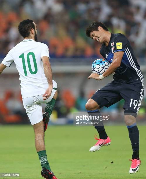 Saudi Arabia's Mohammed Alsahlawi and Japan's Hiroki Sakai fight for the ball during the FIFA World Cup 2018 qualification football match between...
