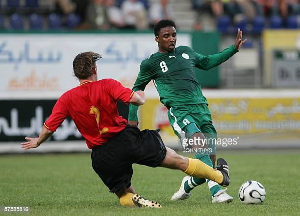 Saudi Arabia's Mohammed Noor Hawsawi vies for the ball against Belgian's Pieter Collen during their friendly football match in Sittard, 11 May 2006,...