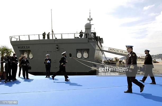 Saudi Arabia's Navy commander Prince Fahd Bin Abdullah bin Mohammad walks past the frigate Mecca 03 April 2004 in the French Mediterranean port city...