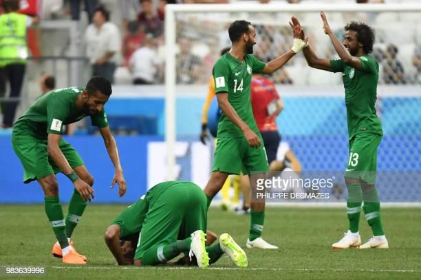 TOPSHOT Saudi Arabia's players celebrate after forward Salem AlDawsari scored during the Russia 2018 World Cup Group A football match between Saudi...