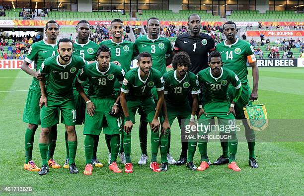 Saudi Arabia's players pose during the Group B Asian Cup football match between Uzbekistan and Saudi Arabia in Melbourne on January 18 2015 AFP PHOTO...