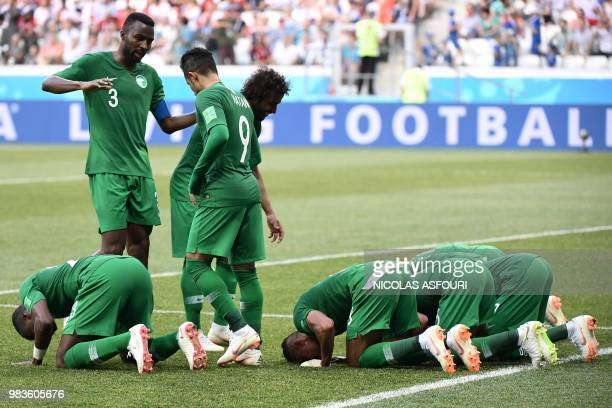 TOPSHOT Saudi Arabia's players react after midfielder Salman AlFaraj scored from the penalty spot during the Russia 2018 World Cup Group A football...