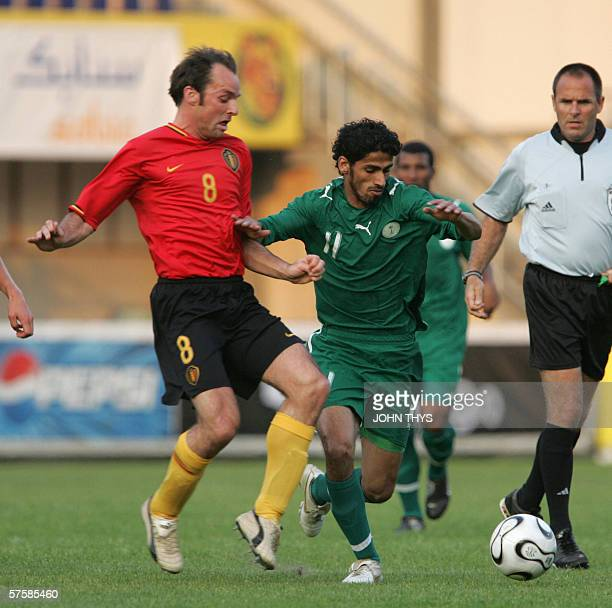 Saudi Arabia's Saad Meshal Al Harthi vies for the ball against the Belgian's Bart Goor during their friendly football match in Sittard, 11 May 2006,...