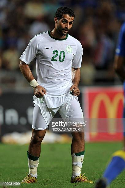 Saudi Arabia's Yasser Al Qahtani pull his shorts as he react after failing to score against Thailand during their World Cup 2014 qualifier football...