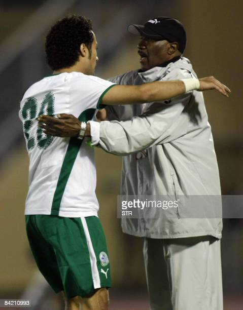 Saudi Arabia's Yasser alQahtani celebrates with his coach Nasser alJohar after scoring their first goal against Yemen during the 19th Gulf Cup...