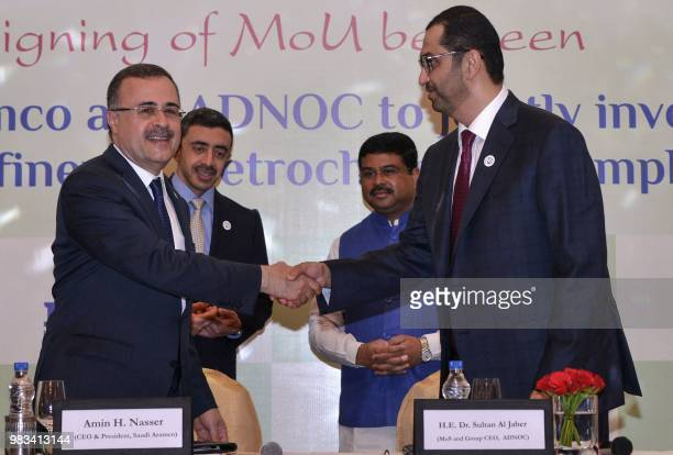 Saudi Aramco CEO Amin Nasser and Abu Dhabi National Oil Company chief executive and United Arab Emirates Minister of State Sultan Ahmed Al Jaber sign...