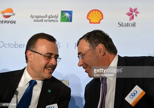 Saudi Aramco CEO Amin Nasser talks with Total CEO Patrick Pouyanne during a press conference following a meeting of the Oil and Gas Climate...