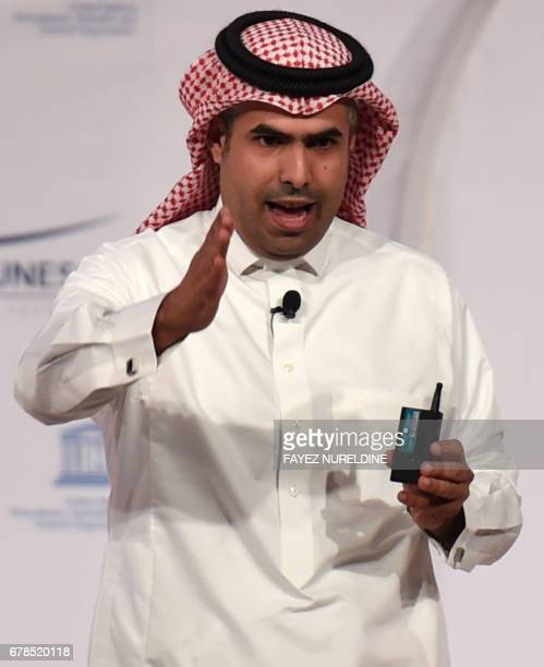 Saudi artist Ahmed Mater presents his work on stage during the UNESCO NGO Forum in Riyadh on May 3 2017 Artists in Saudi Arabia are pushing...