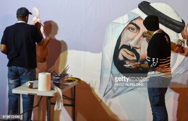 Saudi artists paint a mural portrait of Crown Prince Mohammed bin Salman during the 32nd Janadriyah Culture and Heritage Festival held on the...