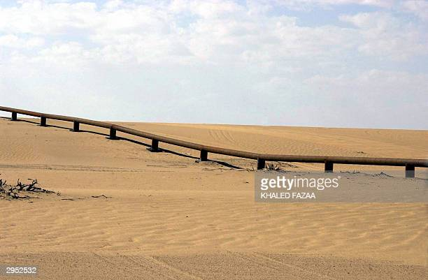 Saudi barrier is seen 09 February 2004 at the border line with Yemen near AlBoqo border outlet in the northern Yemeni province of Sadah Saudi and...