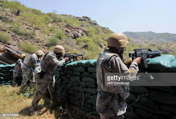 Saudi border guards keep watch along the border with Yemen in the alKhubah area in the southern Jizan province on October 3 2017 The post in alKhubah...