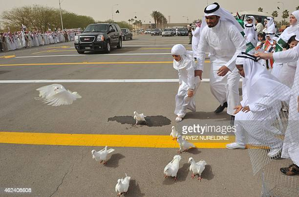 Saudi children run after white doves as crowds greet the convoy transporting King Abdullah bin Abdul Aziz upon his arrival in the Saudi capital...