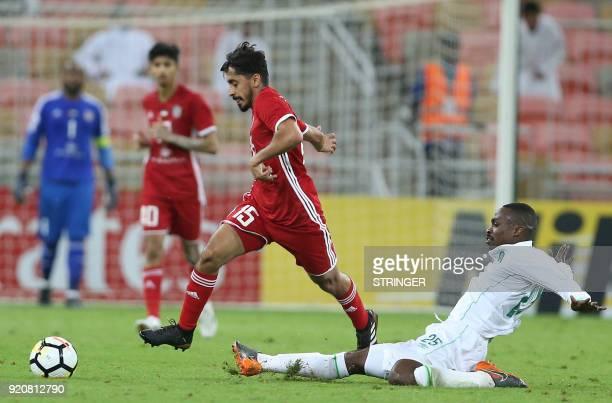 Saudi club AlAhli's Motaz Hawsawi vies for the ball against UAE's AlJazira's Khalfan Mubarak during their AFC Champions League match between alAhli...