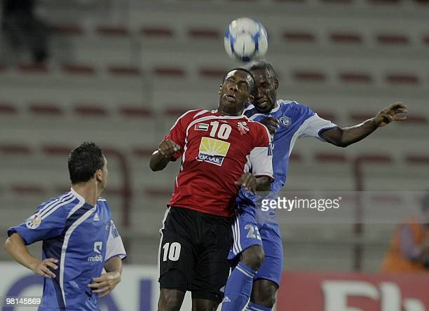 Saudi club AlHilal player Hassan Khairat competes with Emirati AlAhli club opponent Ahmed Khalil during their AFC Champions League Group D football...