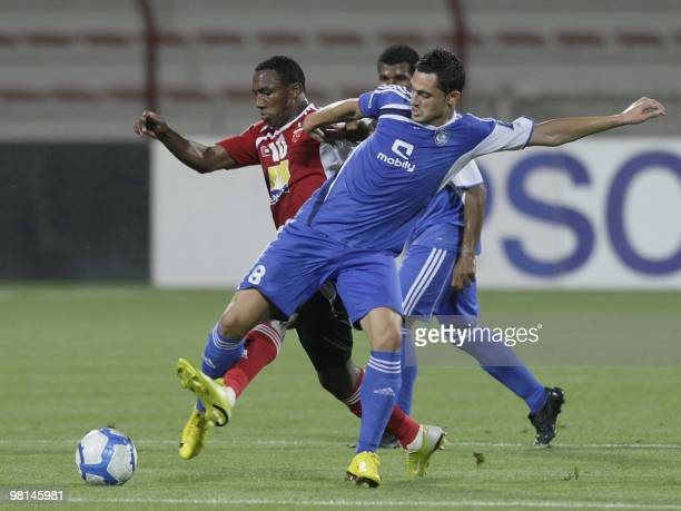 Saudi club AlHilal player Mirel Radoi fights for the ball with Emirati AlAhli club opponent Ahmed Khalil during their AFC Champions League Group D...