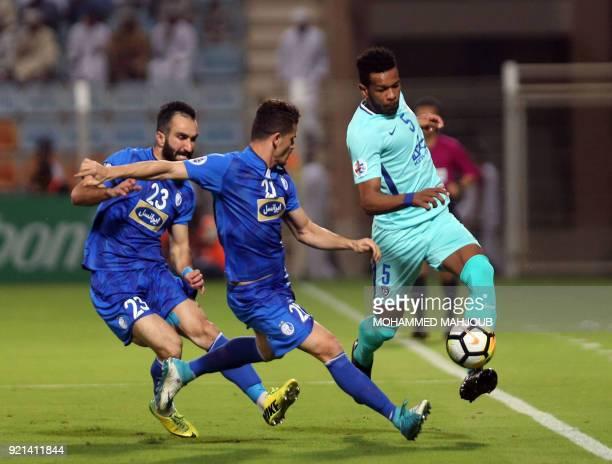 Saudi club AlHilal's Ali Hadi ALBulayhi fights for the ball with Dariush Shojaeian and Vorya Ghafouri of Iranian club Esteghlal during their Asian...