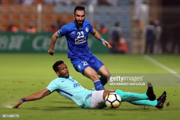 Saudi club AlHilal's Ali Hadi ALBulayhi fights for the ball with Dariush Shojaeian of Iranian club Esteghlal during their Asian Champions League...