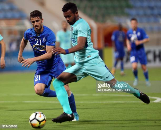 Saudi club AlHilal's Ali Hadi ALBulayhi fights for the ball with Vorya Ghafouri of Iranian club Esteghlal during their Asian Champions League...