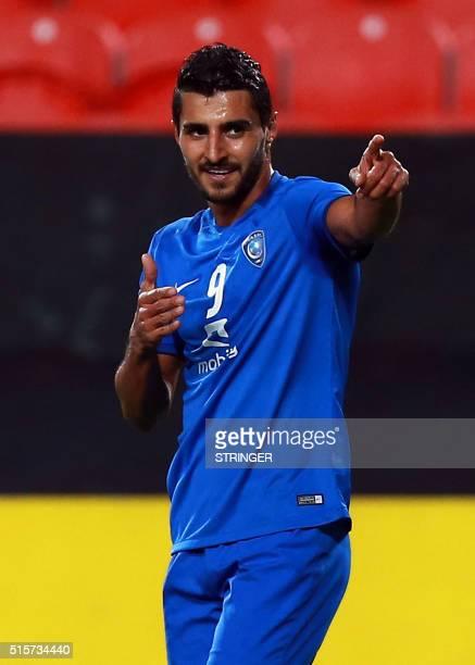 Saudi club AlHilal's Brazilian Ailton Almeida celebrates after scoring a goal during their Asian Champions League group C football match against...