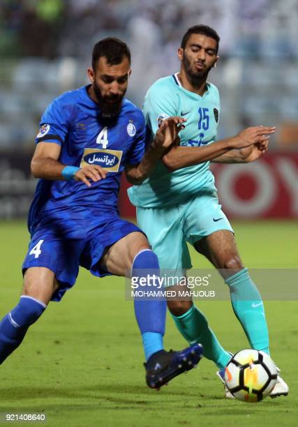 Saudi club AlHilal's Mujahid Mubarak fights for the ball with Roozbeh Cheshmi of Iranian club Esteghlal during during their Asian Champions League...