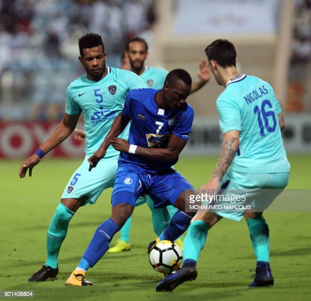 Saudi club AlHilal's Nicolas Lommel and Ali Hadi ALBulayhi fight for the ball with Mame Baba Thiam of Iranian club Esteghlal during their Asian...