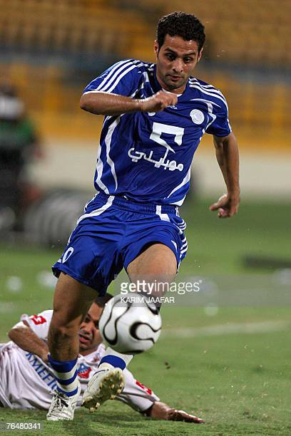 Saudi club AlHilal's player Yaser alQahtani leaves AlKuwait club player Yaqub alTaher behind during their Gulf Council Championship League football...