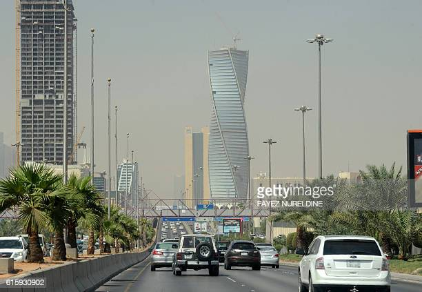 Saudi commuters drive down a main street in the capital Riyadh on October 18 2016 A sevenfold hike in visa fees to do business in Saudi Arabia risks...