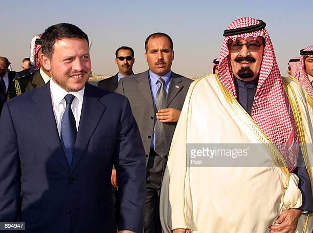 Saudi Crown Prince Abdullah bin Abdel Aziz greets King Abdullah II of Jordan upon his arrival January 27 2002 in Riyadh Saudi Arabia King Abdullah...