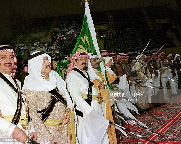 Saudi Crown Prince Abdullah bin Abdel Aziz takes part in a traditional sword dance with members of the royal family in Riyadh late 24 January 2001 at...