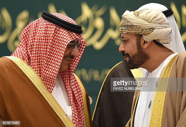 Saudi Crown Prince and Interior Minister Mohammed bin Nayef talks with his Omani counterpart Hamud bin Faisal alBusaidi during the 27th ordinary...