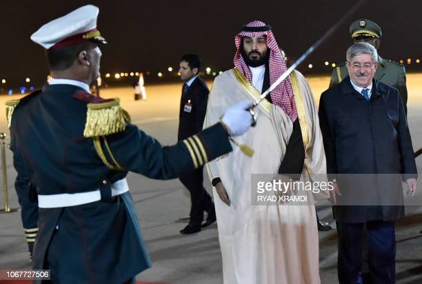 Saudi Crown Prince Mohammed bin Salman and Algerian Prime Minister Ahmed Ouyahia inspect an honour guard upon the former's arrival at Algiers...