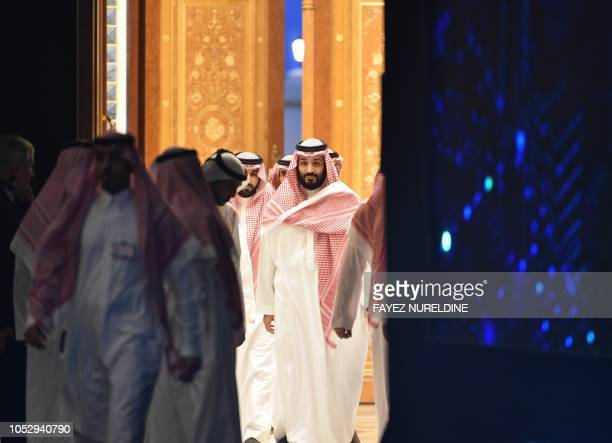 TOPSHOT Saudi Crown Prince Mohammed bin Salman arrives to attend a session during the Future Investment Initiative conference in the capital Riyadh...
