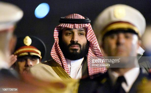Saudi Crown Prince Mohammed bin Salman is seen behind a military band upon his arrival at Algiers International Airport southeast of the capital...