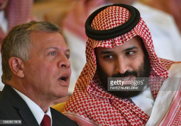 Saudi Crown Prince Mohammed bin Salman talks to Jordan's King Abdullah II during the Future Investment Initiative FII conference in the Saudi capital...