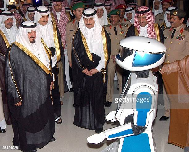 Saudi Crown Prince Sultan bin Abdul Aziz is welcomed by a Robot during the opening ceremony of the Prince Sultan Center for Science and Tecnology in...