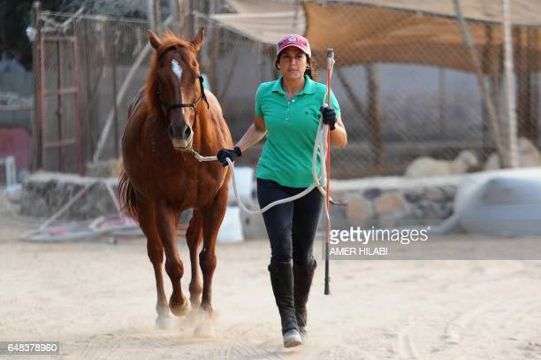 Saudi Dana alGosaibi walks a horse during a training session on March 1 in the Red Sea city of Jeddah The 35yearold Saudi horse trainer dreams of...