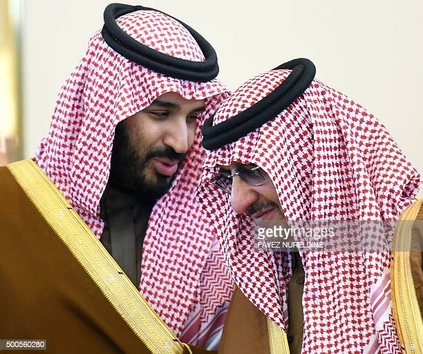 Saudi Defence Minister Mohamed bin Salman talks with Crown Prince and Interior Minister Mohammed bin Nayef during the 136th Gulf Cooperation Council...