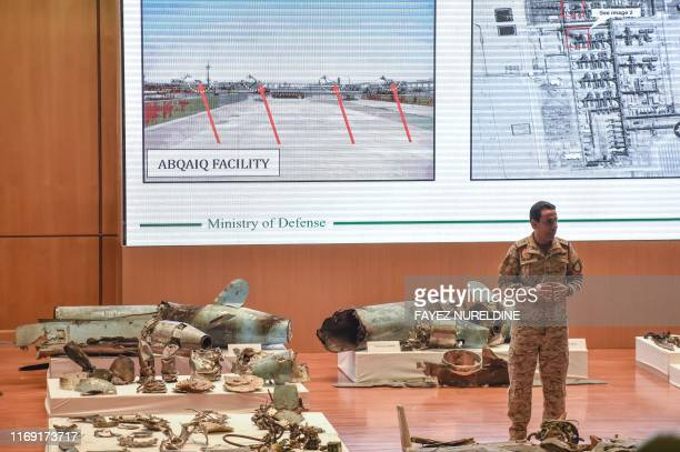 Saudi defence ministry spokesman Colonel Turki bin Saleh alMalki displays pieces of what he said were Iranian cruise missiles and drones recovered...