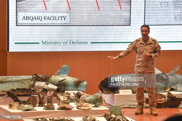 TOPSHOT Saudi defence ministry spokesman Colonel Turki bin Saleh alMalki displays pieces of what he said were Iranian cruise missiles and drones...