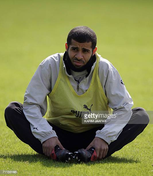 Saudi defender Abdulaziz Khathran stretches as he takes part in a training session at Bad Nauheim Park in Frankfurt 06 June 2006 ahead of the Fifa...