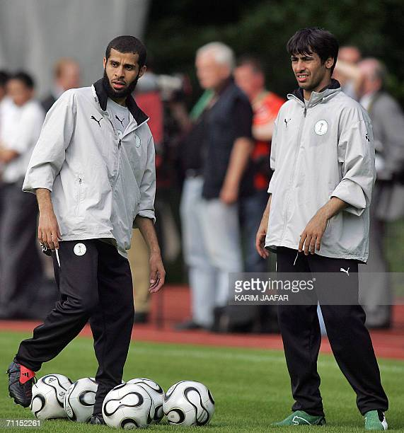 Saudi defenders Abdulaziz Khathran and Hussein Sulimani are seen during their training session at Bad Nauheim Park in Frankfurt 07 June 2006 ahead of...