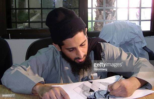 Saudi detainee draws an Arabic word from the Koran while in the art center at the rehabilitation center outside of Riyadh Saudi Arabia on Wednesday...